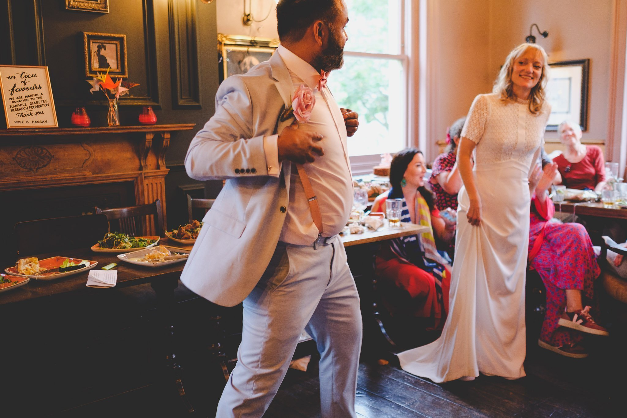 Groom dancing at wedding reception in The Marquis Cornwallis Pub in Bloomsbury London