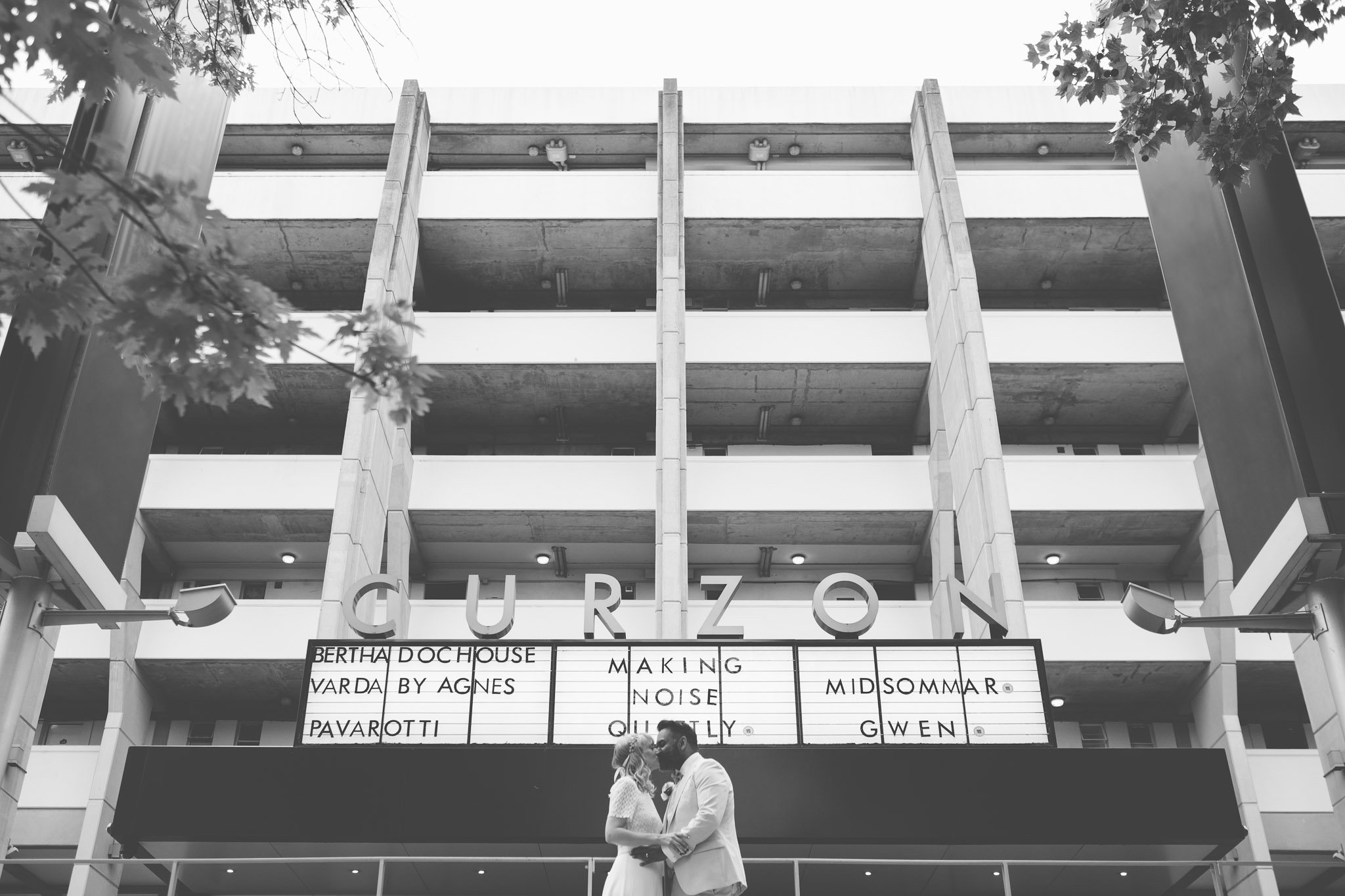 Creative portrait of a bride & groom outside the Curzon cinema, Bloomsbury London. Photography by thatthingyoupluck.