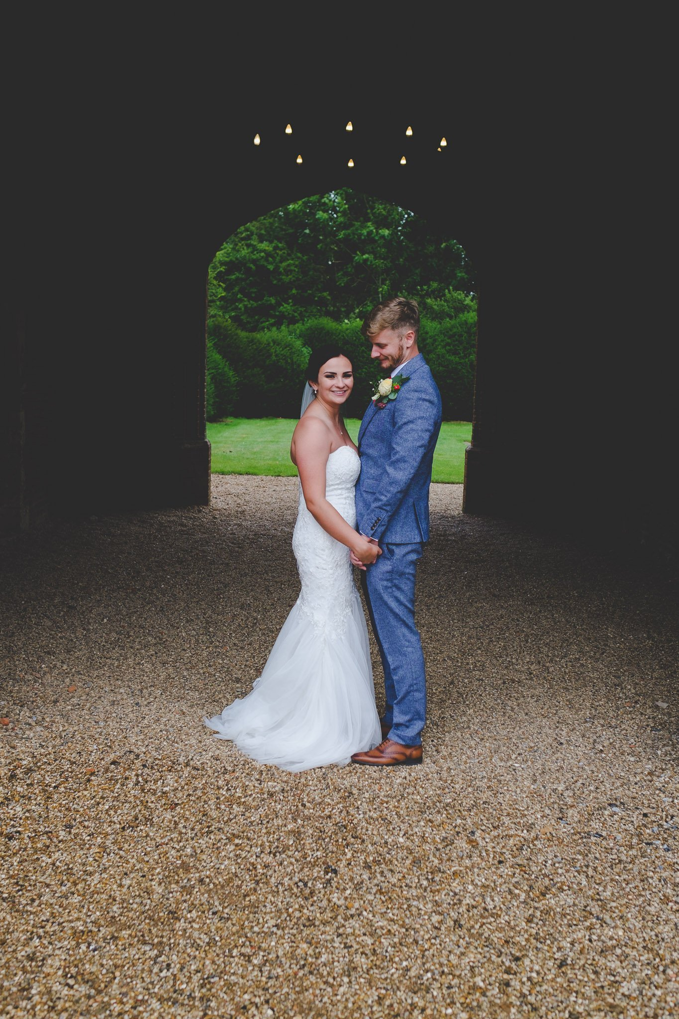 Portrait of a just married couple holding hands at Leez Priory. Photography by thatthingyoupluck.